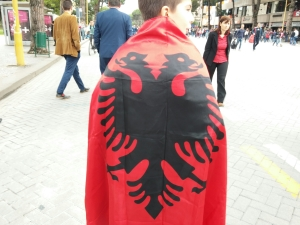 After a soccer win, Albanians adorned with excitement and their flag.